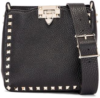 Valentino Rockstud Messenger Bag in Black | FWRD