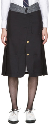 Thom Browne Navy Reconstructed Sack Skirt $3,200 thestylecure.com