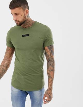 Religion t-shirt in khaki with logo patch and curved hem