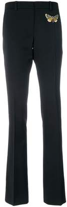 Gucci moth embroidered skinny flared trousers