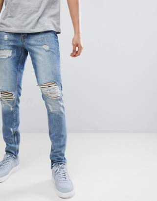 Criminal Damage Jeans In Blue With Distressing