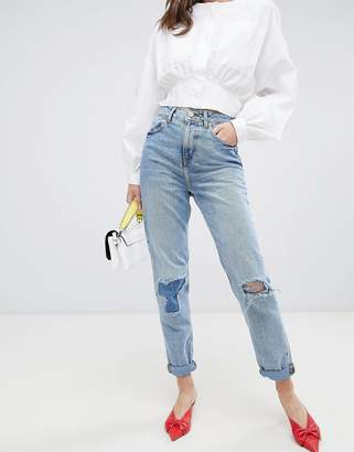 Asos DESIGN Recycled Ritson rigid mom jeans in divinity rich mid blue wash with rip & repair detail