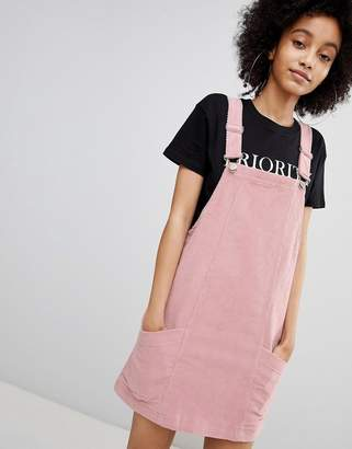 Bershka baby cord dungaree dress in pink