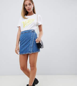 Asos DESIGN Petite denim wrap skirt in stonewash blue