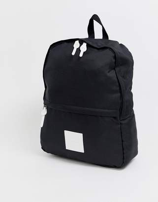 Asos Design DESIGN backpack in black with white pu logo patch