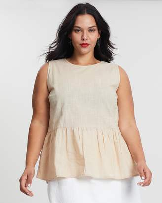 ICONIC EXCLUSIVE - Shell Peplum Top