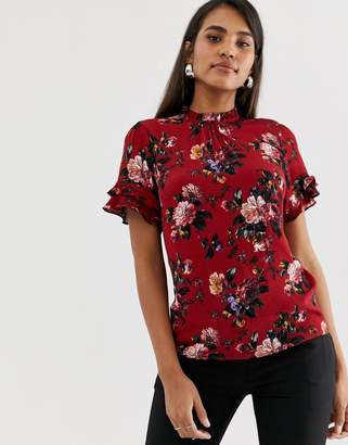 Oasis high neck blouse with ruffle cap sleeves in red floral