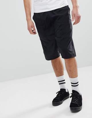 Religion Drop Crotch Shorts In Black