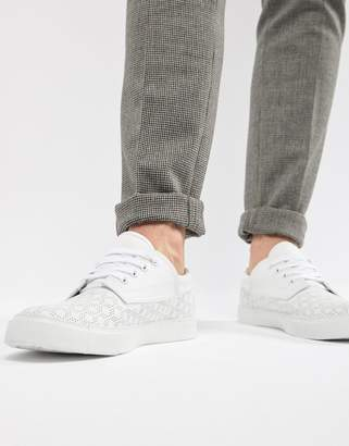 Asos DESIGN vegan friendly lace up plimsolls in white with perforation