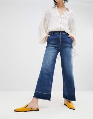 Free People Vintage Raw Hem Flared Jeans
