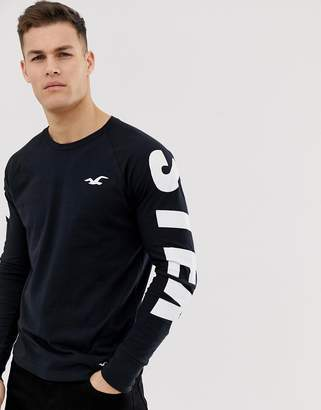 Hollister relaxed fit sleeve logo long sleeve top in black/white