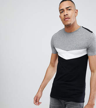 Asos DESIGN Tall muscle fit t-shirt with roll sleeve and chevron color block in twisted jersey