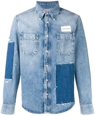 at Farfetch · Calvin Klein Jeans patchwork denim shirt 85f8051935ac