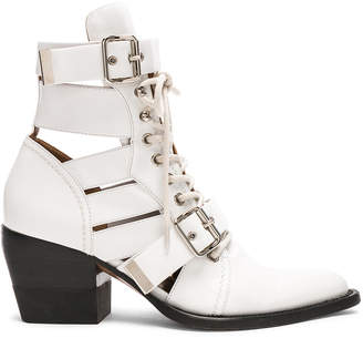 Chloé Leather Rylee Lace Up Buckle Boots in White | FWRD