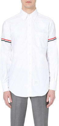 THOM BROWNE Signature-stripe regular-fit cotton-twill shirt $360 thestylecure.com