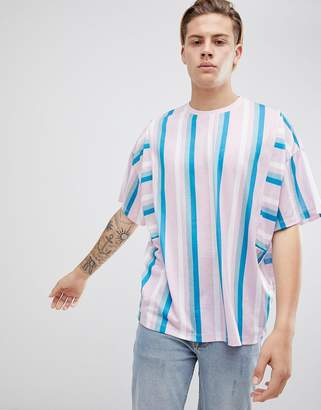 Asos DESIGN oversized t-shirt with pastel vertical stripe and panel detail