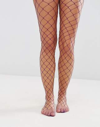 Asos DESIGN Oversized Fishnet Tights in Purple