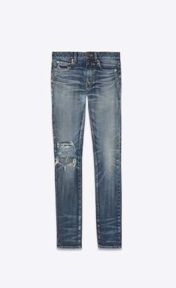 Saint Laurent Mid-Rise Skinny Jeans In Faded And Torn Blue Denim