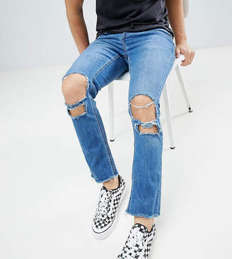 Mennace Relaxed Super Skinny Skinny Cropped Jeans With Rips and Raw Hem In Mid Wash