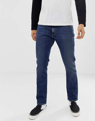 Wrangler larston slim tapered fit jeans in indigo wit mid wash