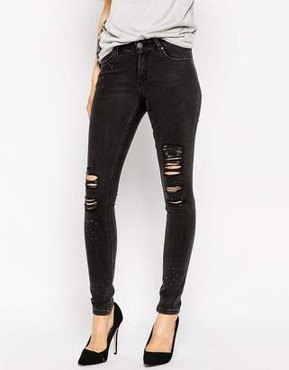 Asos DESIGN Lisbon Skinny Midrise Jeans in Washed Black with Shredded Rips