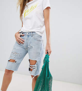 Reclaimed Vintage revived longer length Levis shorts with extreme rips