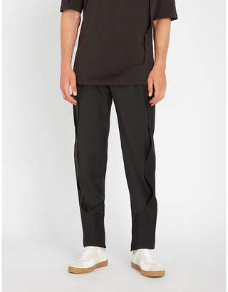 Chalayan Seam-detail tapered woven trousers