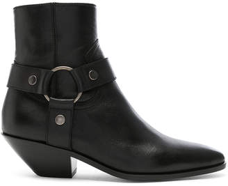 Saint Laurent West Strap Ankle Boots in Black | FWRD