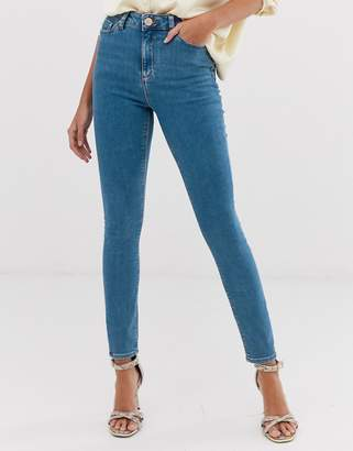Asos DESIGN Ridley high waist skinny jeans in light wash