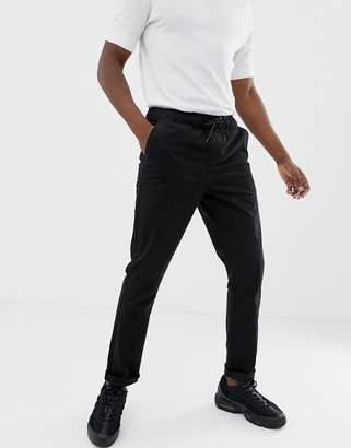 Asos DESIGN slim chinos in black with elastic waist