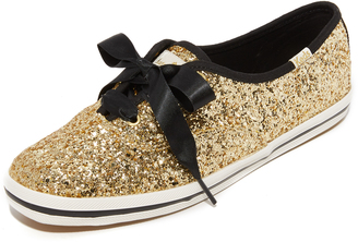Kate Spade New York Glitter Tuxedo Bow Sneakers $85 thestylecure.com