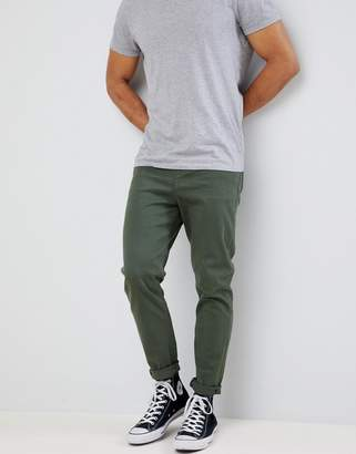 Asos DESIGN tapered jeans in green