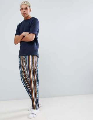 Asos Design DESIGN woven straight pyjama bottoms in aztec print