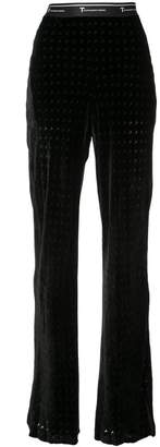 Alexander Wang monogram print flared trousers