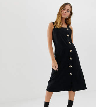 Asos DESIGN Petite midi pinafore dress with large button detail