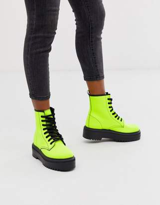 Asos Design DESIGN Attitude chunky lace up boots in neon