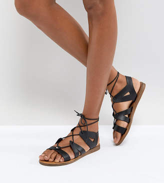 eac4d97a254f at ASOS · Office Saffy Black Leather Gladiator Lace Up Sandals