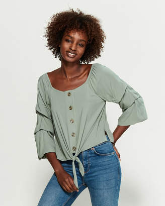 Almost Famous Crave Fame By Pickup Sleeve Knotted Top