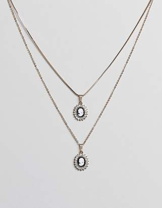 Asos DESIGN pack of 2 necklaces with vintage style cameo with pearl and crystal detail in gold