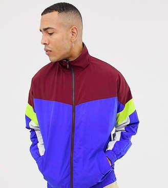 Asos DESIGN festival Tall windbreaker track jacket in color block navy
