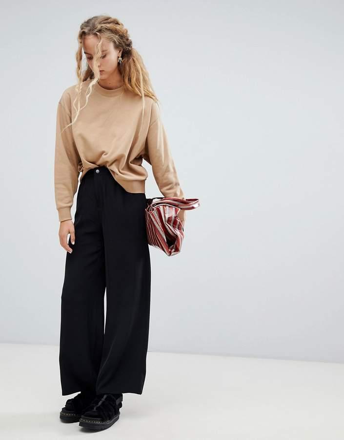 popper waist wide leg trousers in black