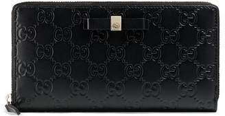 Gucci Bow Signature zip around wallet