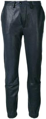 Closed slim fit leather trousers