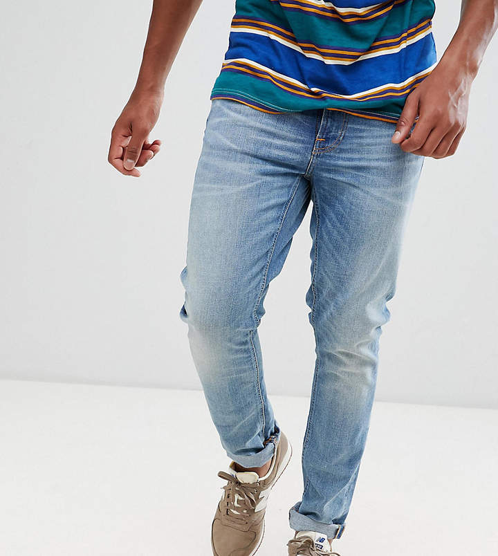 Nudie Jeans Co Lean Dean tapered organic cotton jeans in blue tilt
