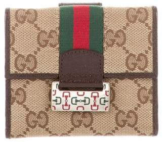 Gucci GG Canvas Web Compact Wallet brown GG Canvas Web Compact Wallet