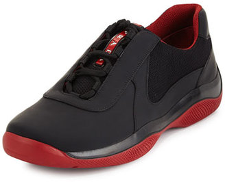 Prada Punta Ala Leather Sneaker, Black/Red $550 thestylecure.com
