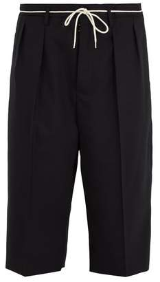 Maison Margiela Cropped-length wool trousers