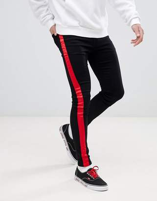 Sixth June super skinny jeans in black with red side stripe