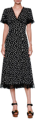 Dolce & Gabbana Polka-Dot Flutter-Sleeve Midi Dress, Black/White $3,495 thestylecure.com