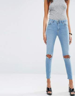 ASOS RIDLEY Skinny Jeans In Hiro Wash With Rips $46 thestylecure.com